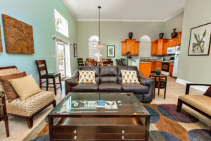 Living room with brown couches and chairs