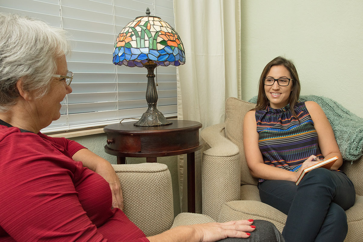 Therapist sitting with client on couch