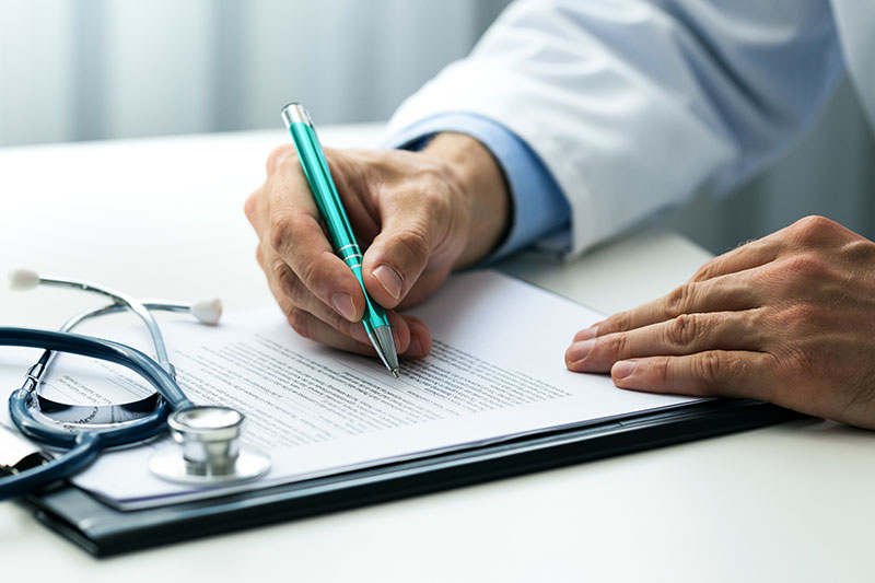 Doctor signing papers