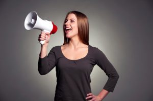 woman_shouting_out_her_success_through_megaphone